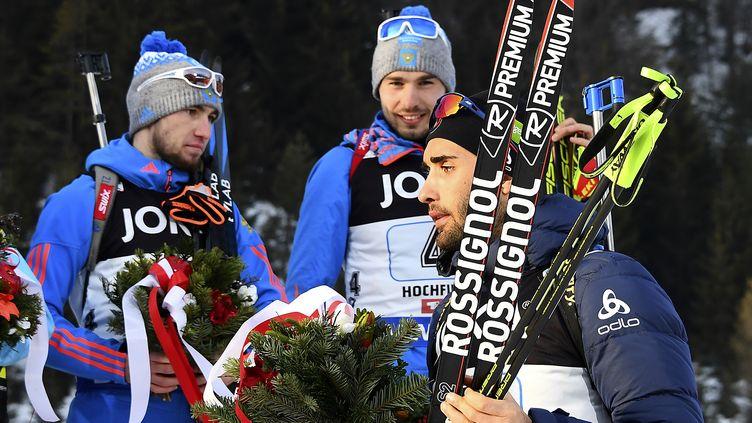 Martin Fourcade remontant sur le podium, jeudi 9 février àHochfilzen en Autriche. (FRANCK FIFE / AFP)