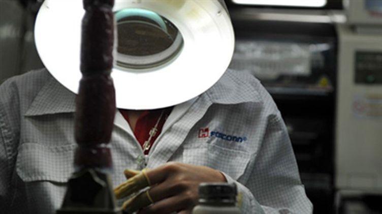 Un employé de Foxconn à l'usine de Shenzen - 26/05/10 (AFP)