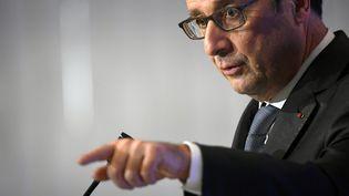 François Hollande lors de la Conférence sur les investissements et leur impact social, au ministère de l'Economie, à Paris, le 24 novembre 2016. (LIONEL BONAVENTURE / AFP)
