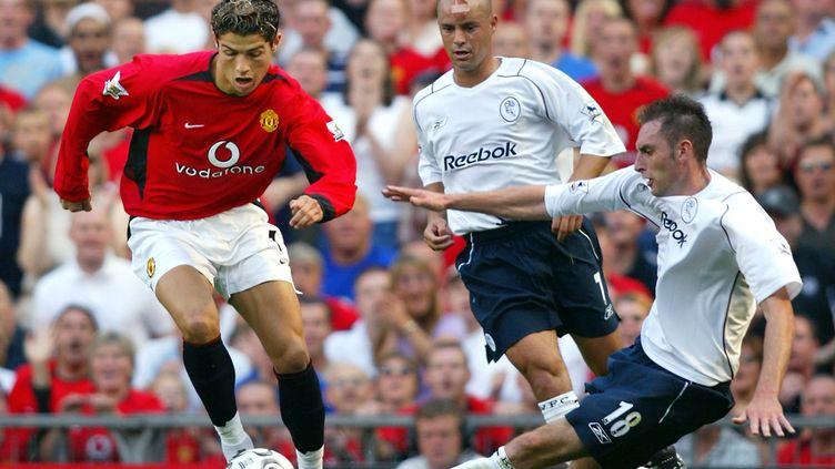 Cristiano Ronaldo lors de son premier match sous les couleurs de Red Devils en 2003. (ADRIAN DENNIS / AFP)