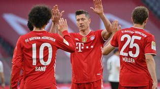 La joie des joueurs du Bayern Munich après leur titre de champion d'Allemagne 2021. (PETER KNEFFEL / DPA-POOL)