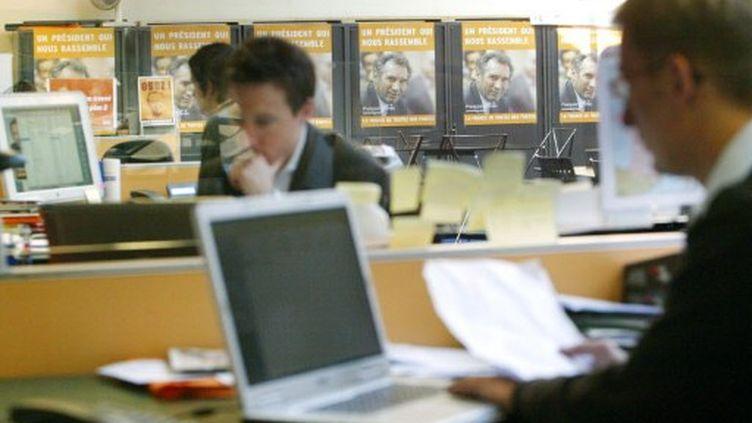 Ordinateurs et politique (MEHDI FEDOUACH / AFP)