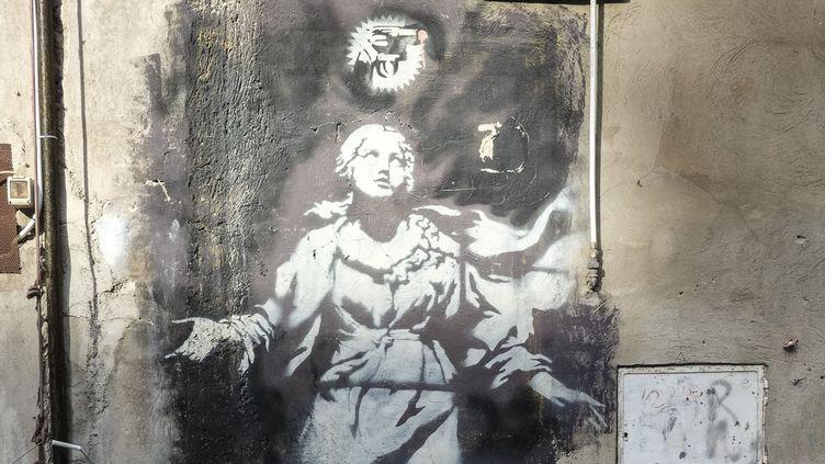Détail de la Madone de Banksy  (Yannis Vlamos/Sipa)