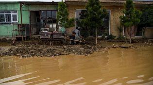 Image d'illustrationd'un village afghan inondé, dans la province de Parwan, le 27 août 2020. (WAKIL KOHSAR / AFP)