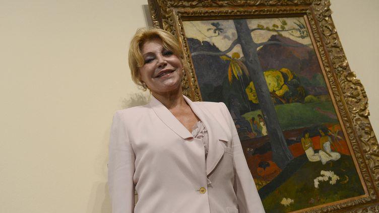"""La baronne Carmen Thyssen-Bornemisza, veuve du magnat industriel Baron Thyssen, à côté du tableau """"Mata Mua"""" de l'artiste français Paul Gauguin au musée Thyssen Bornemisza de Madrid. (PIERRE-PHILIPPE MARCOU / AFP)"""