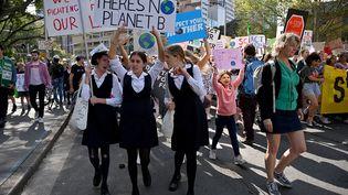 Les écoliers australiens ont donné le coup d'envoi des manifestations mondiales pour le climat, vendredi 20 septembre, à Sydney. (PETER PARKS / AFP)