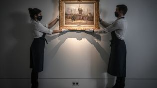 """""""Scène de rue à Montmartre"""" de Vincent Van Gogh en vente chez Sotheby's le 25 mars 2021. (STEPHANE DE SAKUTIN / AFP)"""