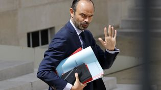 Le Premier ministre, Edouard Philippe, quitte l'Elysée, le 28 juin 2017, à Paris. (PATRICK KOVARIK / AFP)