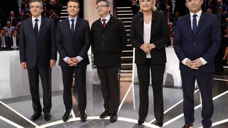 Les candidats à l'élection présidentielle de 2017 Emmanuel Macron, Jean-Luc Mélenchon, Marine Le Pen et Benoît Hamon, lors d'un débat télévisé, le 20 mars 2017. (PATRICK KOVARIK / AFP)