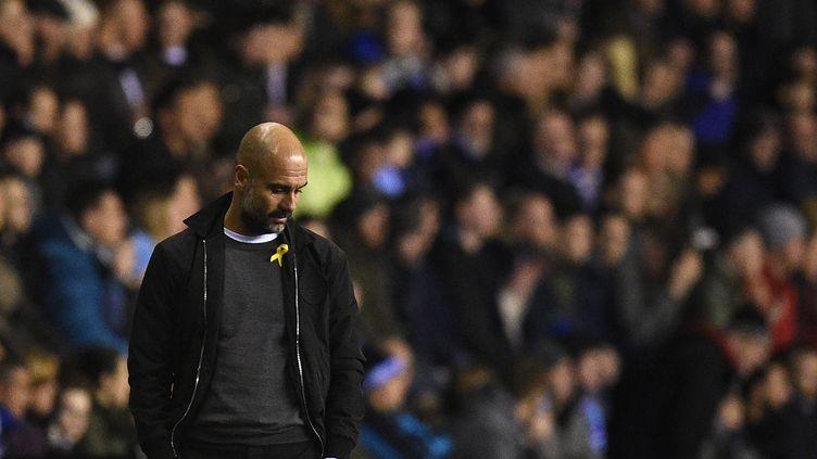 Pep Guardiola  (OLI SCARFF / AFP)