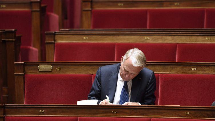 Le député de la Loire-Atlantique Jean-Marc Ayrault attend le début d'une séance à l'Assemblée nationale, le 11 juin 2014, à Paris. (ERIC FEFERBERG / AFP)