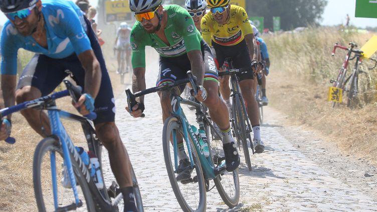 Alejandro Valverde, Peter Sagan et Greg van Avermaet lors du dernier passage du Tour de France sur les pavés, en 2018. (KEI TSUJI / BETTINIPHOTO)