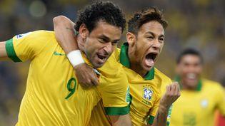 Les attaquants brésiliens Fred et Neymar, donnés favoris du Mondial 2014 par des scientifiques et des statisticiens. (VANDERLEI ALMEIDA / AFP)