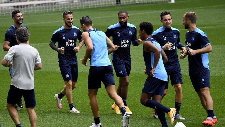 Les joueurs de l'Olympique de Marseille, vendredi, à l'entraînement. (NICOLAS TUCAT / AFP)