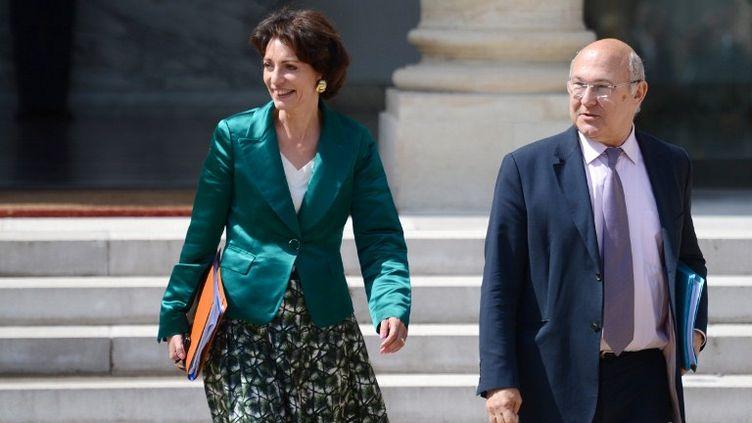 La ministre des Affaires sociales et de la Santé Marisol Touraine et le ministre du Travail, de l'Emploi et du Dialogue social Michel Sapin, le 13 juin 2012 à Paris. (MARTIN BUREAU / AFP)