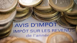 Un avis d'imposition (illustration). (JOEL SAGET / AFP)