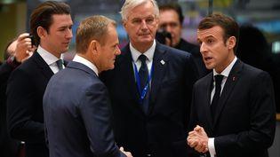 Emmanuel Macron avec le négociateur en chef du Brexit, Michel Barnier, à Bruxelles, le 25 novembre 2018. (JOHN THYS / AFP)
