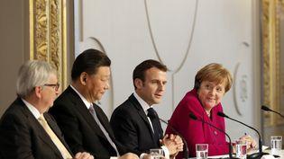 Le président de la Comission européenne,Jean-Claude Juncker, le président chinois, Xi Jinping, le président français, Emmanuel Macron, et la chancelière allemande, Angela Merkel, à Paris, le 26 mars 2019. (THIBAULT CAMUS / POOL /AFP)
