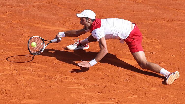 Novak Djokovic en pleine extension (VALERY HACHE / AFP)