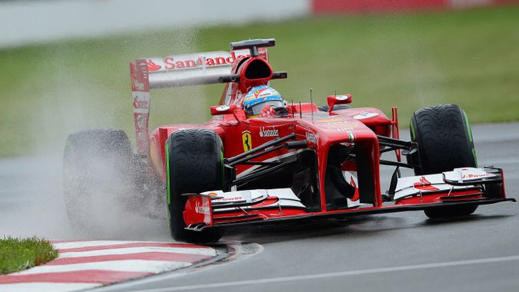 Fernando Alonso sur sa Ferrari (EMMANUEL DUNAND / AFP)