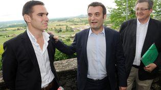 De g. à dr. : Etienne Bousquet-Cassagne, le candidat FN dans la 3e circonscription du Lot-et-Garonne, Florian Philippot, le vice-président du FN, et Michel Guiniot, le directeur de campagne du candidat, le 19 juin à Monflanquin. (MEHDI FEDOUACH / AFP)