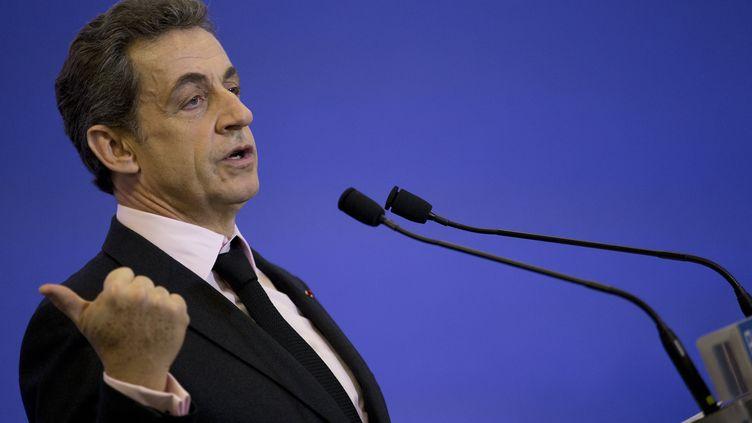 Le président de l'UMP Nicolas Sarkozy, le 8 avril 2015 au siège du parti, à Paris. (KENZO TRIBOUILLARD / AFP)