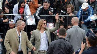 Brad Pitt arrive sur la Croisette  (ANNE-CHRISTINE POUJOULAT / AFP)
