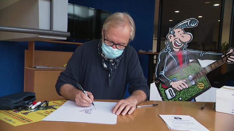 Franck Margerin et son héros Lucien à l'Espace Culturel de Rombas en Moselle. (France 3 Lorraine / Emmanuel André)