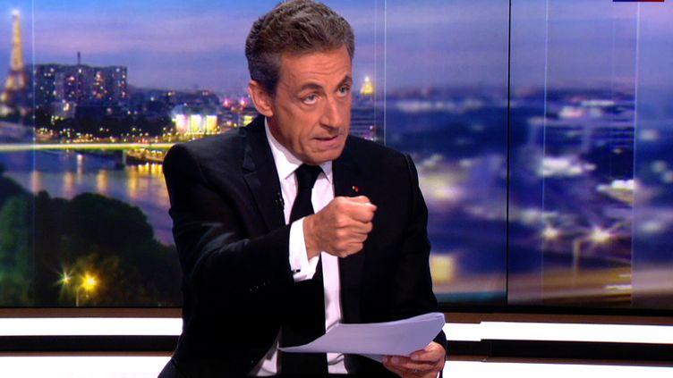 Nicolas Sarkozy sur le plateau du 20 heures de TF1, jeudi 22 mars 2018. (TF1 / AFP)
