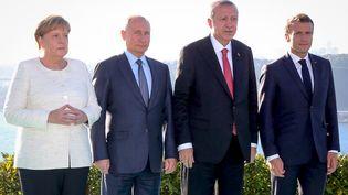 Les dirigeants turc, allemand, russe et français réunis à Istanbul pour un sommet sur la Syrie, le 27 octobre 2018. (KAYHAN OZER / AFP)