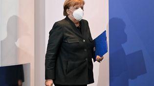 La chancelière allemande Angela Merkel lors d'une conférence de presse sur la situation sanitaire en Allemagne, le 19 janvier 2021 à Berlin. (FILIP SINGER / EPA / AFP)