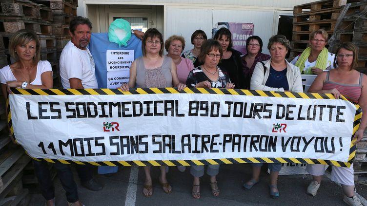 Des salariés de l'entreprise Sodimédical, le 3 septembre 2012, àPlancy-l'Abbaye (Aube). (FRANCOIS NASCIMBENI / AFP)