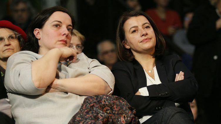 Emmanuelle Cosse et Cécile Duflot, lors d'un meeting à Paris, le 23 février 2016. (MATTHIEU ALEXANDRE / AFP)