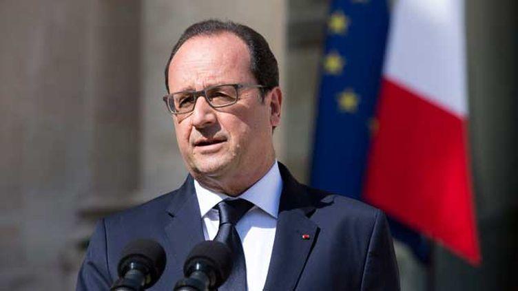 (François Hollande s'exprime dans la cour de l'Elysée le 29 juin à l'issue d'un Conseil des ministres restreint consacré à cette crise grecque © Maxppp)