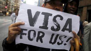 Des manifestants réclament des visas pour les demandeurs d'asile, à Tokyo (Japon), le 9 septembre 2015. (YUYA SHINO / REUTERS)