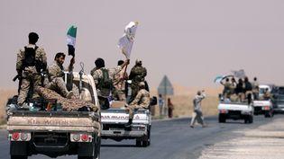 Les forces démocratiques syriennes sur les portes de Raqqa (Syrie), le 6 juin 2017 (RODI SAID / REUTERS)