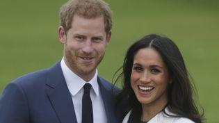 NOVEMBRE 2017 - Et enfin, le prince Harry et Meghan Markle lors de leur première apparition après l'annonce de leurs fiançailles. (DANIEL LEAL-OLIVAS / AFP)