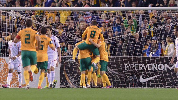 La joie des joueurs Australiens (PAUL CROCK / AFP)