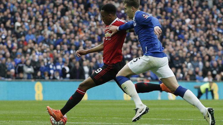 Anthony Martial marque le but victorieux de Manchester United face à Everton (ADRIAN DENNIS / AFP)