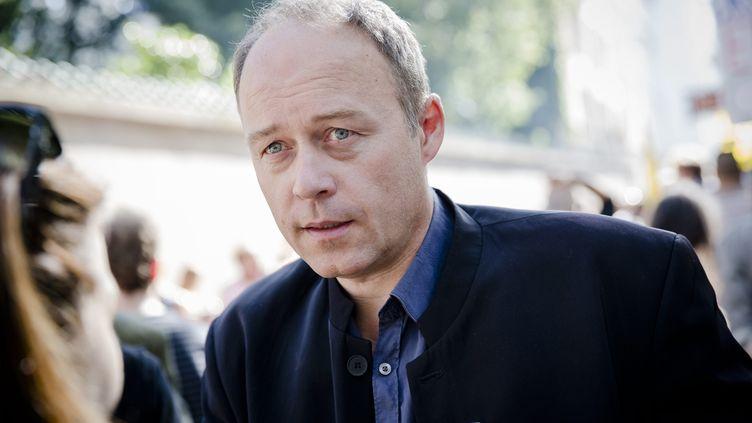 Denis Gravouil,le secrétaire général de la CGT Spectacle, le 1er octobre 2014, rue de Grenelle, à Paris.  (MARLENE AWAAD / MAXPPP)
