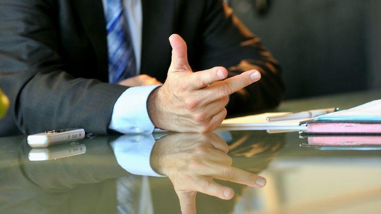 Un homme d'affaires, photographié le 5 février 2013. (MAXPPP)