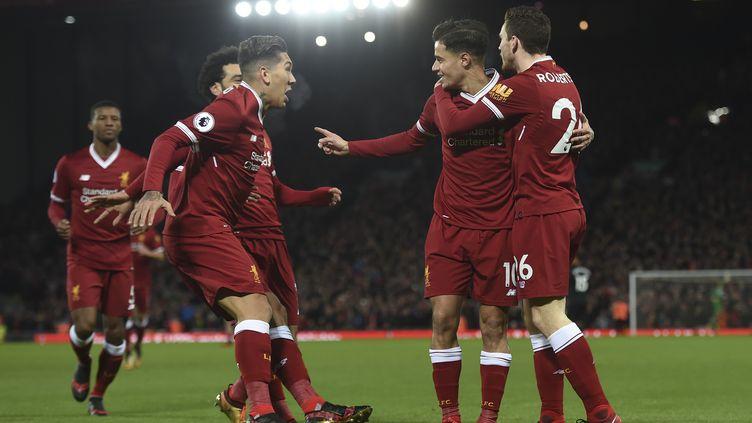 Les Reds fêtant un de leurs buts. (PAUL ELLIS / AFP)