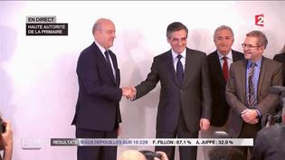 Alain Juppé et François Fillon apparaissentensemble, au siège de la Haute Autorité de la primaire de la droite, à Paris, le 27 novembre 2016. (FRANCE 2)