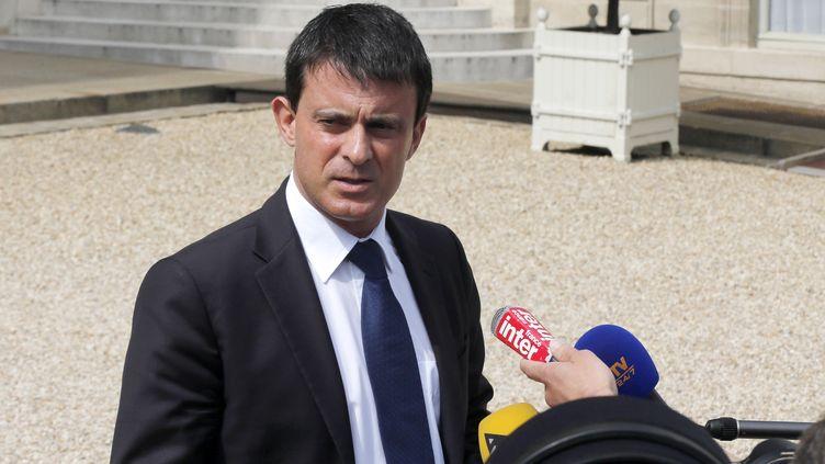 Le ministre de l'Intérieur, Manuel Valls, répond aux questions des journalistes, le 24 juillet 2013 à l'Elysée, à Paris. (FRANCOIS GUILLOT / AFP)