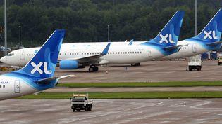 Des avions de la compagnie XL Airways à l'aéroport de Manchester (Royaume-Uni), le 12 septembre 2008. (PAUL ELLIS / AFP)