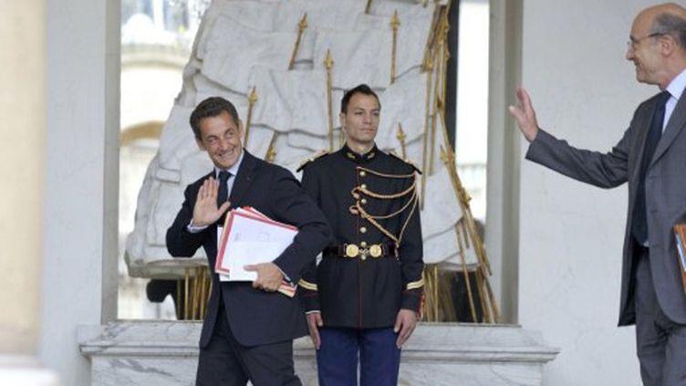 Nicolas Sarkozy et Alain Juppé (AFP)