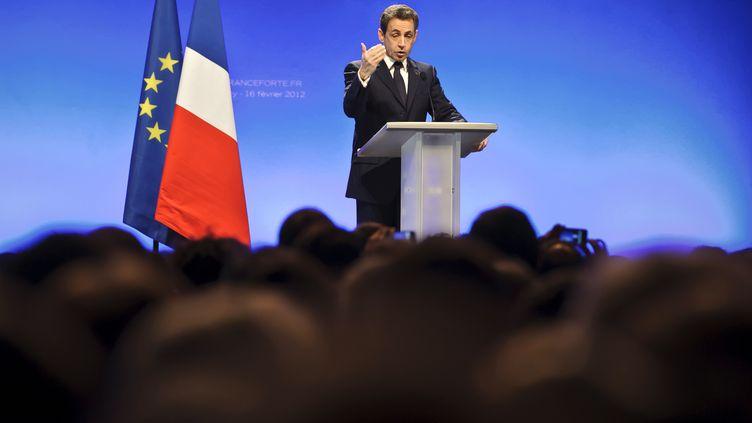 Le président Nicolas Sarkozy tient son premier meeting de candidat, le 16 février 2012 à Annecy (Haute-Savoie). (JEAN-PHILIPPE KSIAZEK / AFP)