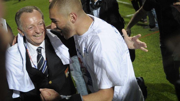 Karim Benzema et Jean-Michel Aulas ont toujours été complices. (JEFF PACHOUD / AFP)