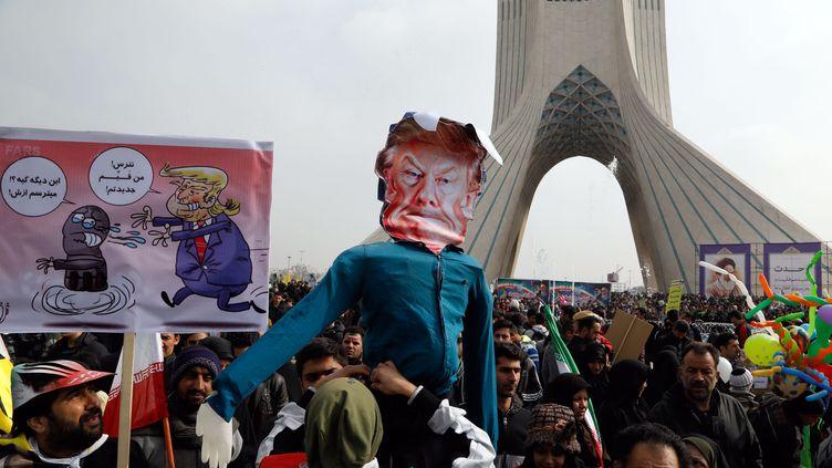 Des Iraniens manifestants à Téhéran le 10 février 2017. (ATTA KENARE / AFP)