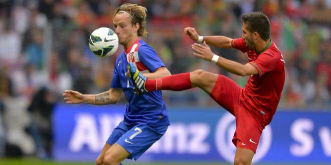 Le Croate Rakitic contre le Portugais Moutinho